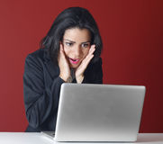 Young business woman shocked using computer Royalty Free Stock Image