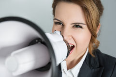 Young business woman shouting with a megaphone. Closeup portrait of young business woman shouting with a megaphone. Leadership consept Stock Images