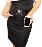 Young business woman showing with black display of mobile phone Royalty Free Stock Photo