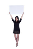 Young business woman showing blank signboard Royalty Free Stock Photo
