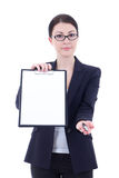 Young business woman showing empty blank clipboard and giving pe Stock Photography