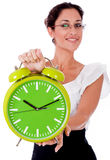 Young business woman showing a green color clock Royalty Free Stock Photo