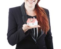 Young business woman showing mini house in her hand Stock Image