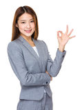 Young business woman showing OK sign. Isolated on white background Stock Photography