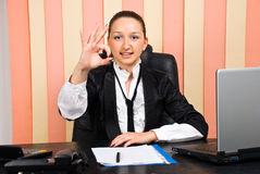 Young business woman showing okay. Young business woman in office showing okay sign hand and smiling,check also Business people Royalty Free Stock Images