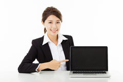 Young business woman  showing and pointing to the laptop Stock Images