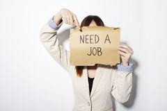 Young business woman showing a poster that says need a job Stock Image