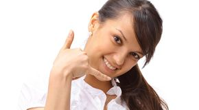 Young business woman showing sign of success. Closeup.young business woman showing sign of success.isolated on white Stock Photos