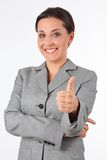 Young business woman showing success sign royalty free stock photography