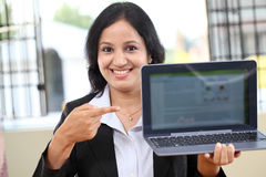 Young business woman showing tablet computer Royalty Free Stock Photo