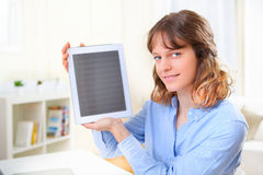Young business woman showing a tablet screen Stock Images