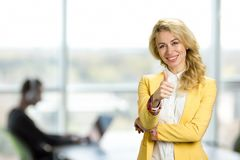 Young business woman showing thumb up. Stock Photos