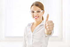 Young business woman showing thumbs up Stock Image