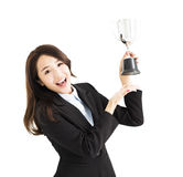 Young Business woman showing trophy. Happy young Business woman showing trophy Royalty Free Stock Image