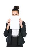 Young business woman shows a sheet of paper Stock Photography