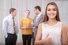 Young business woman shows thumbs up Stock Photo