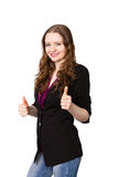 Young business woman shows thumbs-up. Smiling business woman shows thumbs-up-sign Royalty Free Stock Photos