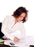 Young business woman signing a document. Business woman signing a document Stock Image