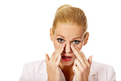 Young business woman with sinus pressure pain Royalty Free Stock Image