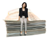 Young business woman sit on a sum of banknote . Stock Images