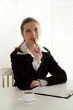 Young business woman sitting Stock Photography
