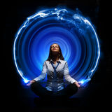 Business woman meditating. Young business woman sitting in asana lotus and meditating Royalty Free Stock Photography