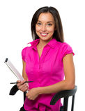 Young business woman sitting on a chair Royalty Free Stock Photos