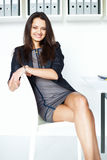 Young business woman sitting on a chair Royalty Free Stock Images