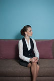 Young business woman. Sitting on a couch Royalty Free Stock Image