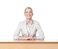 Young business woman sitting at a desk. Isolated Royalty Free Stock Image