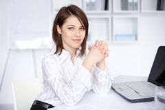 Young business woman sitting at desk at office Stock Image