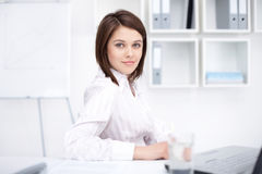 Young business woman sitting at desk at office Royalty Free Stock Images