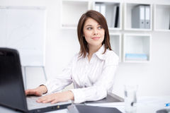 Young business woman sitting at desk at office Stock Photography
