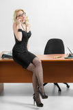 Young business woman sitting at the desk Stock Photos