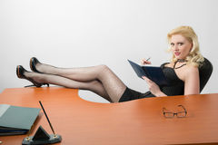 Young business woman sitting at the desk Stock Images