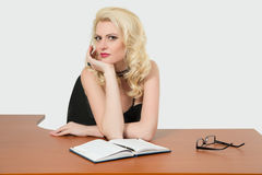 Young business woman sitting at the desk Royalty Free Stock Image
