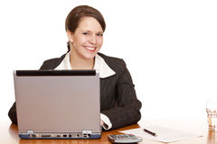 Young business woman sitting happy in office royalty free stock photography
