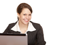 Young business woman sitting happy in office Royalty Free Stock Image