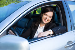 Young business woman sitting in her car Royalty Free Stock Photo