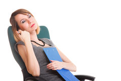 Young business woman sitting with her clipboard isolated Royalty Free Stock Photo
