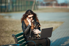 Young business woman sitting at a laptop stock photography