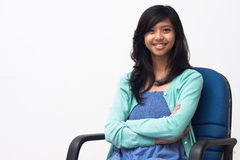 Portrait of young business woman sitting on chair Stock Photography