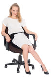 Young business woman sitting in an office chair Royalty Free Stock Photo