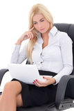 Young business woman sitting on office chair and working with la. Ptop isolated on white background Royalty Free Stock Image