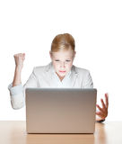 Young business woman sitting at a office desk Royalty Free Stock Photos