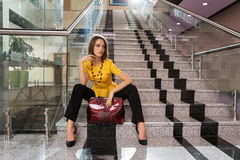 Young business woman sitting on the steps Stock Photography