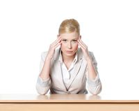 Young business woman sitting at a table Stock Images