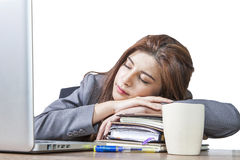 Young business woman sleeping at workplace. Business woman sleeping on laptop taking a power nap during work Isolated Royalty Free Stock Photos
