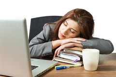 Young business woman sleeping at workplace Royalty Free Stock Image