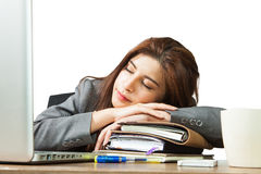 Young business woman sleeping at workplace Stock Photography